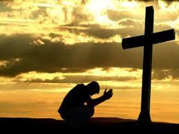 pray-before-cross.png